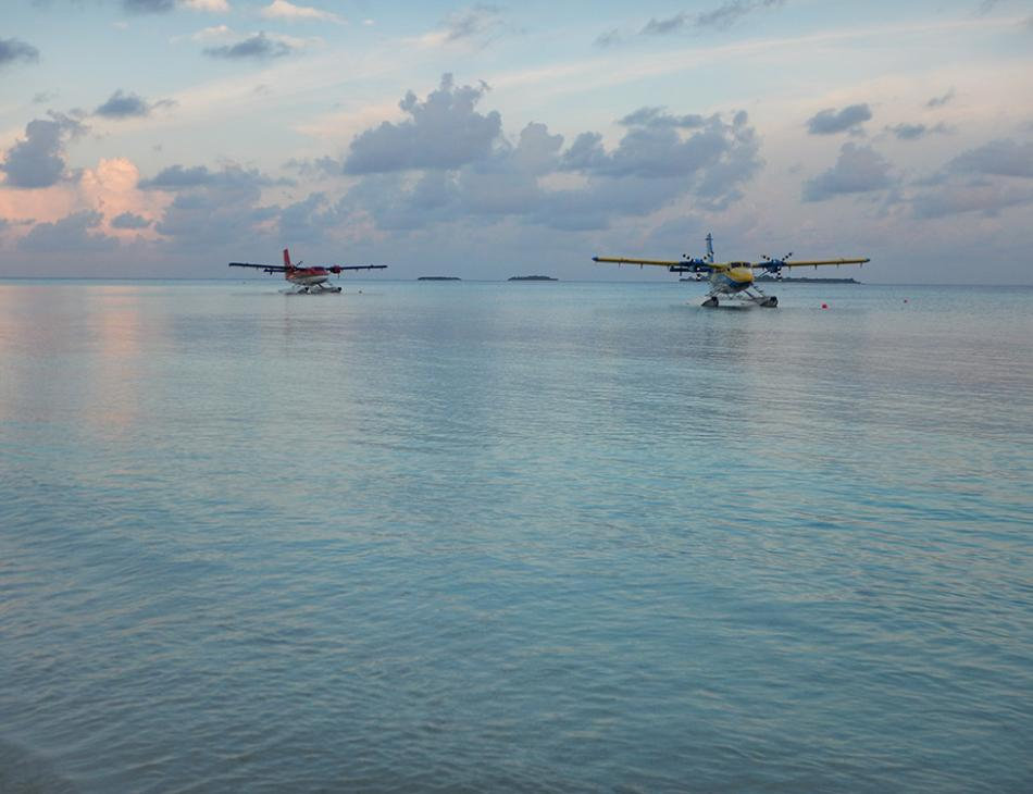 Seaplanes At Dusk Kuredu Maldives